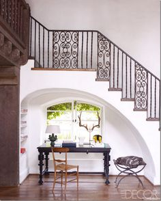 black desk from Lars Bolander. Beautiful! It's such a pretty nook with its arch under the staircase. I wonder why more people don't do arched niches under staircases instead of closets where they store luggage