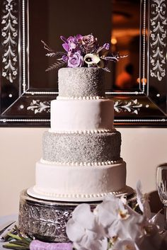 Awesome wedding cake...switch the gray to red and purple!