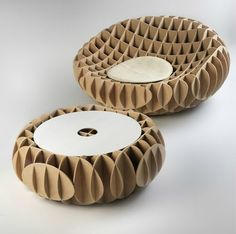 """Most of Gruba's work is focused on salvaged materials. Their """"La Cartonera"""" line of tables is made from corrugated cardboard sheets that manufacturers have discarded because they weren't of the best quality for their purposes. They also repurpose recycled wood into flooring and paneling."""