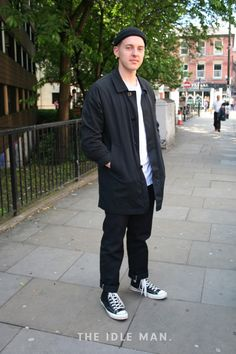 Men's Street Style | Monochrome Street Style - This monochrome style creates an edgy casual look, with basic black jeans and a white tee matched with casual black high top converse contrasting to the smart black Mac however we think this totally works. For extra street style points we're loving the black beanie. | Shop the look at The Idle Man.