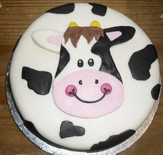 this smily cow looks like a first birthday cake...MOO!