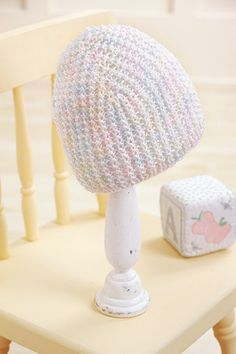 Pastel baby hat made with the Knook™. Buy this in a book bundle: http://www.leisurearts.com/sale/bundles/knook-baby-value-pa…