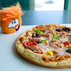 make your own pizza with a puffle click picture to go to www.pufflepizza.com
