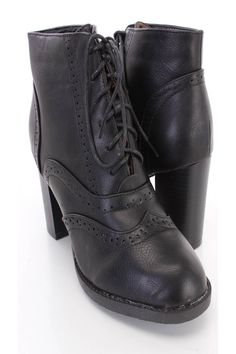These sexy and stylish chunky heel booties are a must have! The features include a faux leather upper with a round closed toe, wing tipped toe, perforated detailing, lace up tie design, smooth lining, and cushioned footbed. Approximately 3 1/2 inch heels.