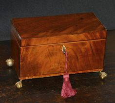 Antique English Georgian period Mahogany Tea Caddy Box C.1785 A/F   18th century tea caddy of a rectangular form with 3 compartments resting on 4 ball and claw feet. Mahogany veneered with boxwood, tulip wood and rosewood banding and inset lozenge shaped ivory escutcheon. Inside of the lid and the Antique Items, Vintage Items, Tiny Shop, Pergola Lighting, Tea Caddy, Jewelry Case, Green Velvet, Hope Chest, Georgian
