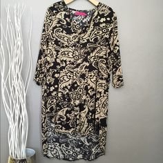 Black/Gold patterned tunic or dress Patterned tunic top cute with leggings or tights.  Could be worn as a dress. Boohoo Tops Tunics