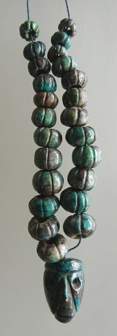 brown matrix turquoise string with a focal, carved in  preColumbian style