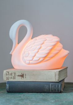 Swans in a Lifetime Lamp. As an interior decorator with an elegant aesthetic, youve seen your fair share of delightful decor, yet no piece has looked as lovely as this ivory swan lamp from Streamline! #white #wedding #modcloth