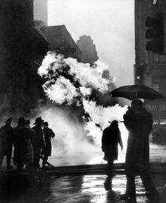 Dec. 4, 1957: Flames billowed four stories high at Broadway and 40th Street, after an explosion in a pit where men were working on a gas main. Three sustained minor burns; one of them, Hugh Harrity of the Bronx, had singed eyebrows and eyelids, but refused treatment. The spectacle was blamed on a lighted cigarette. Photo: The New York Times