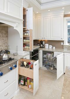 maximizing kitchen storage... check out the swiveling storage for those annoying deep corners