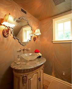An interesting wallpaper and mirror can make all the difference in giving you an unique bathroom