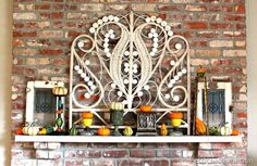 mantel display for fall...note the headboard in the display...I never woulda thought of this!