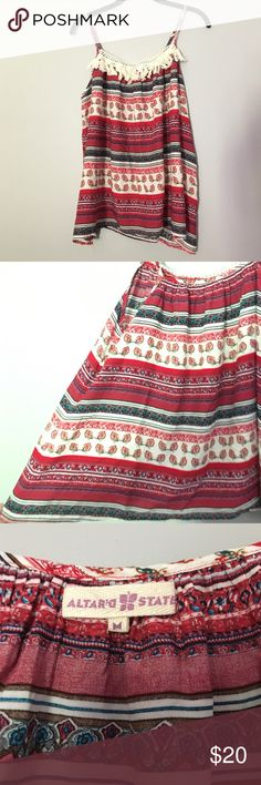 Swing Tank Silky feeling Altar'd State top. Like new with cute fringe at the top! It's a swing top so it is very forgiving around the tummy area and very comfy! It hits right about the waist line. Altar'd State Tops Tank Tops
