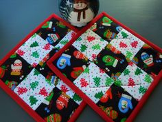 Christmas Fabrics Quilted Pot Holders Nine Patch Pattern/Set of two with colors of red, green and black by RubysQuiltShop on Etsy