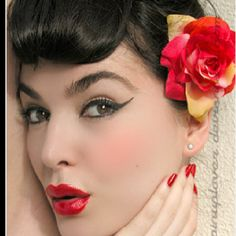 Great example of pinup hair and makeup.