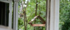 Minimalist Bird Feeder - This minimalist bird feeder from Kaufmann Mercantile blends style with practicality and is the perfect accent to both rustic and modern backyards.