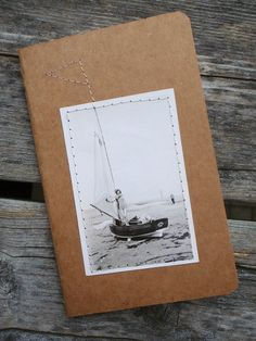 sew a paper picture onto a paper notebook instead of just gluing it