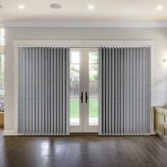 Modern vertical blind featuring a lovely woven design in a cool monochrome mix of black and silver