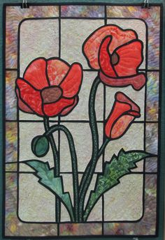 Stained glass look floral wall hanging using batik fabrics.