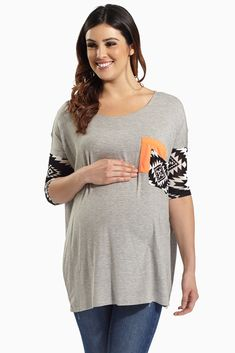 With a bold tribal print, this maternity ¾ sleeve top features a vibrant popping color block pocket and sleeve to make this top stand out.