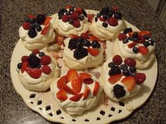 Mini Pavlovas with berries. A small version of my own wedding cake. Did you know that the Pavlova cake was dedicated to a Russian ballet dancer by an Australian chef?