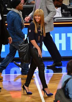 Beyonce.Make Leather Pants Work for Casual Occasions    For a basketball game, Beyoncé wore leather pants with an oversize sweater. Edgy, yes, but the star also shows that mixing hard and soft materials can make for the best off-duty outfits.