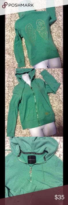 """Victoria's Secret """"Supermodel Essentials"""" Jacket Green with gold accents.  Zipper is silver tone.  Size Large. Good Condition. Approx 21 inches from armpit to armpit flat. Victoria's Secret Jackets & Coats"""