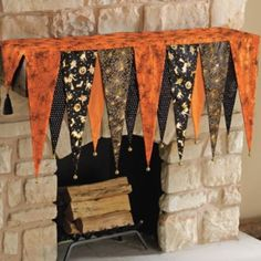 Bewitching Halloween Mantel Scarf: http://www.grandinroad.com/bewitching-halloween-mantel-scarf/373953?defattrib===0 Slip our Bewitching Halloween Mantel Scarf over your mantel, then top with your own favorite pieces to create a Halloween spectacle they'll never forget. This mantle decoration is crafted from vividly dyed, high-quality fabrics with spooky Halloween imagery. (October 2012)