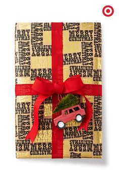 It's a two-fer! This sweet ride doubles as both a gift topper AND an ornament that's totally Christmas tree-worthy. You're on a roll! Gift wrap and toppers in stores only.