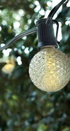 """Set the mood under the pergola or umbrella—all without an outlet. A warm, soft white light glows from the crystal-like pattern of large, 2"""" dia. bulbs."""