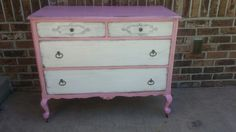 Pink and white distressed dresser