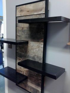 Custom made wall shelving unit from reclaimed pallet wood. Cost $375. Contact LWi Custom Cabinets. Custom designs available.
