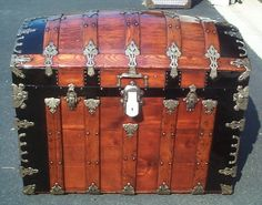 Restored camel back steamer trunk