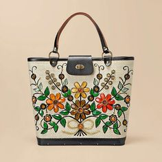 Crafted by Collins of Texas, this vintage purse is a pretty and unique vintage find. Colorful embellishments add charm to the intricate floral pattern, and the size is perfect for everyday use.