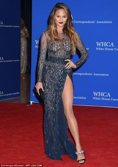 Leggy lady: Chrissy Teigen showed off her legs in a midnight blue gown slashed to the hip bone as she attended the White House Correspondents' Dinner in Washington D.C. on Saturday