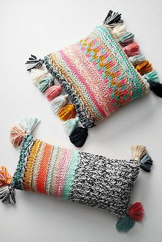 Snuggling with these knit pillows feels just like hugging a soft sweater.