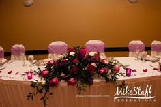 #wedding reception decorations #centerpieces #tablescapes #reception details #Michigan wedding #Mike Staff Productions #wedding details #wedding photography http://www.mikestaff.com/services/photography #pink flowers #roses #short centerpieces