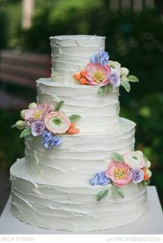 Simple, rustic buttercream wedding cake with sugar paste flowers in spring colors <3