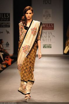 A model showcases a creation by designer Vineet Bahl on Day 1 of the Wills Lifestyle India Fashion Week (WIFW) 2013, held in Delhi.