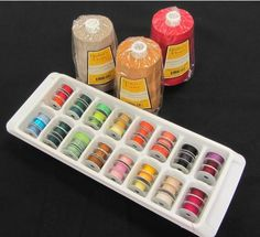 Bobbin Storage Using An Ice Cube Tray . simply use a clean ice cube tray. Each cubbie holds three bobbins, meaning the typical tray can hold 48 bobbins. Just add more trays and stack them for efficient storage . Bobbin Storage, Sewing Room Storage, Sewing Room Organization, My Sewing Room, Thread Storage, Fabric Storage, Organizing Ideas, Craft Room Organizing, Fabric Boxes