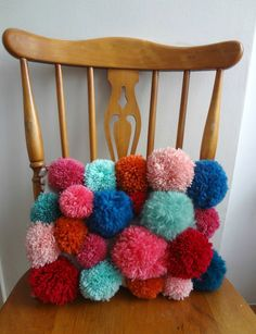 Ruby will love this. She is big into making pom poms right now... pom pom pillow DIY