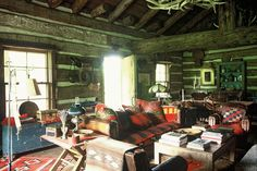 The Ranch has five guest houses or 'cabins' including the Little Blue Pony cabin, pictured. In the sitting room, built from logs brought from a nineteenth-century barn in Montana, the leather sofa is by Ralph Lauren.