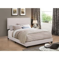 "Queen Bed CS350051Q Features: • Bed upholstered in fabric • Entire bed packaged in one carton • Drop ship ready • Individual chrome nailhead trim • Solid wood legs finished in espresso • Available in ivory, charcoal, grey, and brown Dimensions: Queen Bed 64.25""W x 86.50""D x 49.50""H"