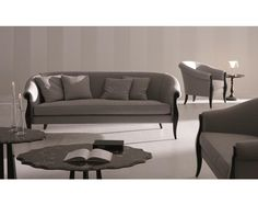 Siebel 2 Seater sofa OPERA CONTEMPORARY draws its energy from the values of tradition and it is aimed at a sophisticated audience by offering a high quality product that is enriched by materials and craftsmanship that are typical of the most qualified Made in Italy products.