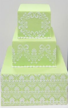 Green Wedding Cake With White Scroll