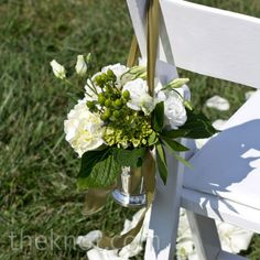 with red accents (ribbon) instead of green in stalls for wedding    White Ceremony Chair Decor
