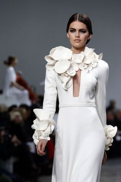 Wearable Art - long white dress with cone-like 3D shapes around the collar and cuffs - 3D fashion details; surface adornment // Stephane Rolland