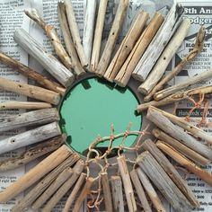 Working in a new driftwood mirror wreath using an old bait bag and a mirror I found in my workshop. Not sure how I feel about the greenish tint of the mirror. What do you think?