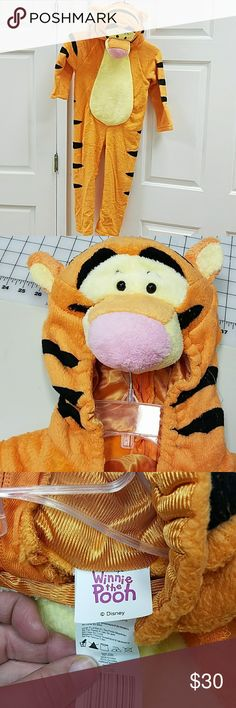 Childs Tigger costume Brand bew, most in original packages. Fits child 4-6x. Plush and super comfortable one piece.2 not in packages as we tried them on but did not use them Disney Costumes Halloween
