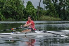 L3M1AP1-PHOTOJOURNALISM - REGATTA TRAINING. Manual mode 1/200 sec, f/8.0, ISO 250, 105 mm lens. Hand held in dingy.  On this miserable wet morning, I managed to capture the concentration on Lachlan's face who has been rowing for only 2 months & is performing exceptionally well.